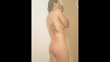 Sexy tattooed coed dreams of cock in the shower