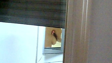 Wife showering through the window spy