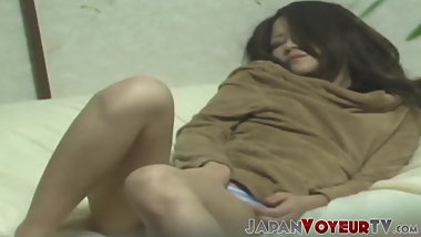 Gorgeous Japanese lady playing with her pussy
