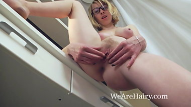 Natinella masturbates after working at her desk