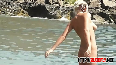 Sexy beach nudists enjoy the hot summer day on voyeur cam