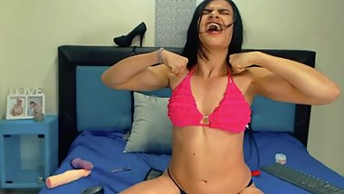 Young cam girl flexes biceps as hard as she can
