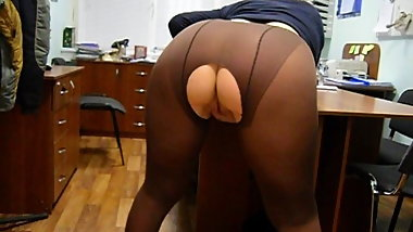 Pushuna shows her big ass wearing riped pantyhose