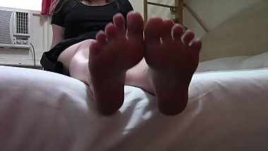 white chick showing off her stinky small feet