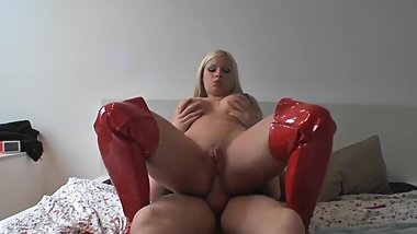 Chick in red thigh high boots gets it in the ass