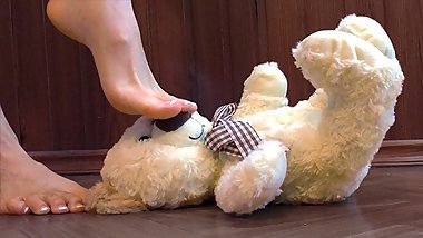 Hard foot crush of little cute plush teddy bear toy