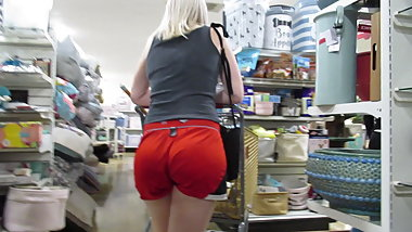 Blond PAWG shopping in lil' red deep-wedge booty shorts