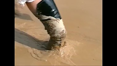 Lack boots and corset in mud