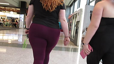 Redhead PAWG showing off hot ass in purple leggings