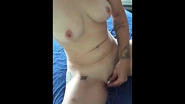 Pleasuring myself with vibrator to lesbian porn on massage table