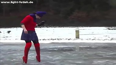 RED BALLET BOOTS IN SNOW AND ICE