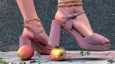 Big high heels sandals crush nectarines