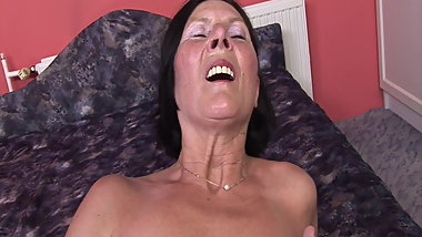 60+ Grandma enjoys dildo and young mans cock