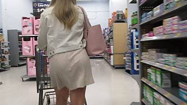Blond plump-ass PAWG in short see-thru skirt in Walmart