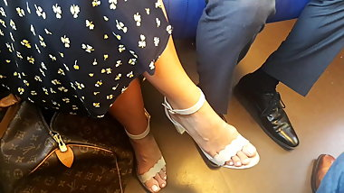 Woman with sexy legs feet and shoes in train