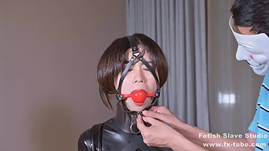 Latex girl on single gloves and gagging
