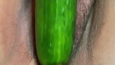 Moki fucking her hairy wet cunt with a ripe cucumber