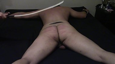 Slave receives 50 hard strokes to the ass with a wooden crop.