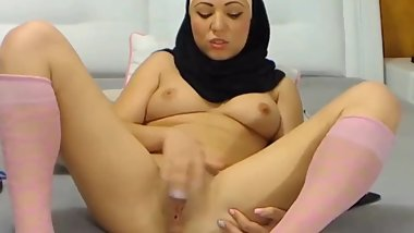 horny arab babe fucks her pussy with a black dildo