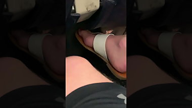 Red Toes In Sexy Flip Flops On Plane Sleeping