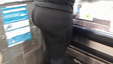 Fat round booty in shiny black spandex tights