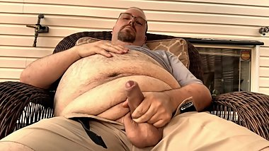 FAT CHUB RUBBING HIS BIG BELLY AND STROKING HIS UNCUT COCK OUTSIDE