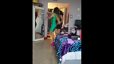 2 latinas in pantyhose and sexy dresses dancing