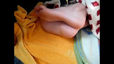 Sleeping boy's sensitive soles