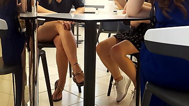 girl sexy crossed legs, feets under table