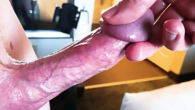 Up close on a huge throbbing cock head, in light of hotel window