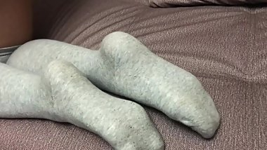 Sexy girl show feet in pantyhose and gray knee socks stockings