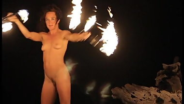 nude woman playing with fire