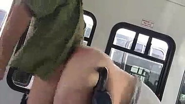 Wife bent over bus