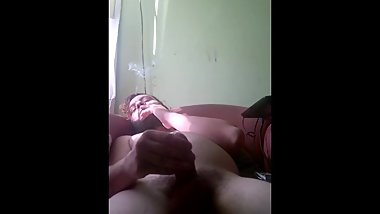 Having a wank and slapping my cock while smoking a roll up