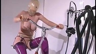 Personal assistant shows blonde rubber outfits and bondage