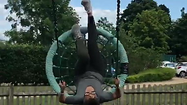 Frankie Bridge sitting in a swing