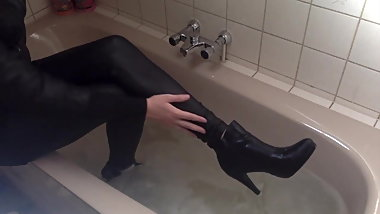 Sexy tight pants ankle boots and heels in bath