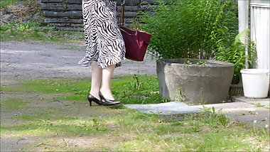 Wife walking in classic high heeled pumps