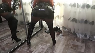 Sexy mistress seduces with her body in latex shirt