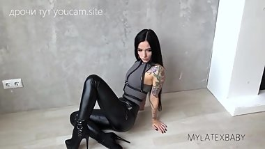 A sexy girl in leather leggings, a photosession