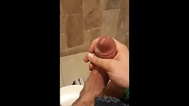 Shaved cock cums in the bathroom