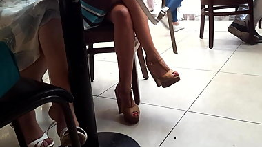girls sexy legs feets heels under table