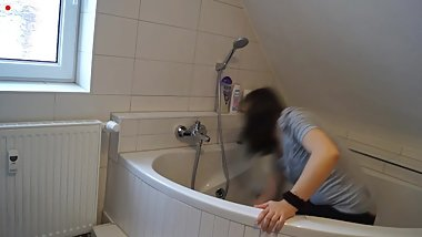 Cleaning bathroom with buttcrack showing
