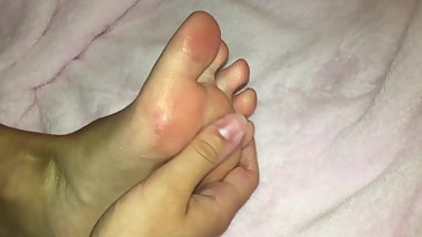Pink Toed Teen Rubs Glitter Lotion On Feet