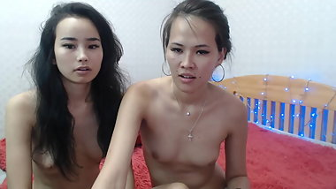 Asian girls playing with each other on cam