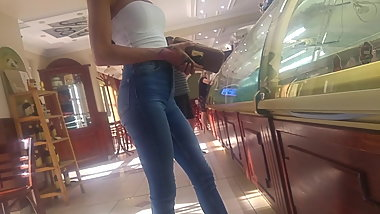 Young skinny mom in shop
