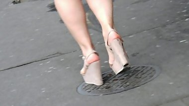 Candid sexy legs in wedges heels