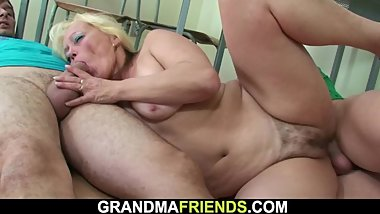 Two boys screw old hairy granny teacher on the floor