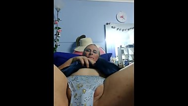 Teasing my wet clit on a stick in blue panties