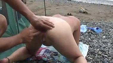 Anal fisting on beach